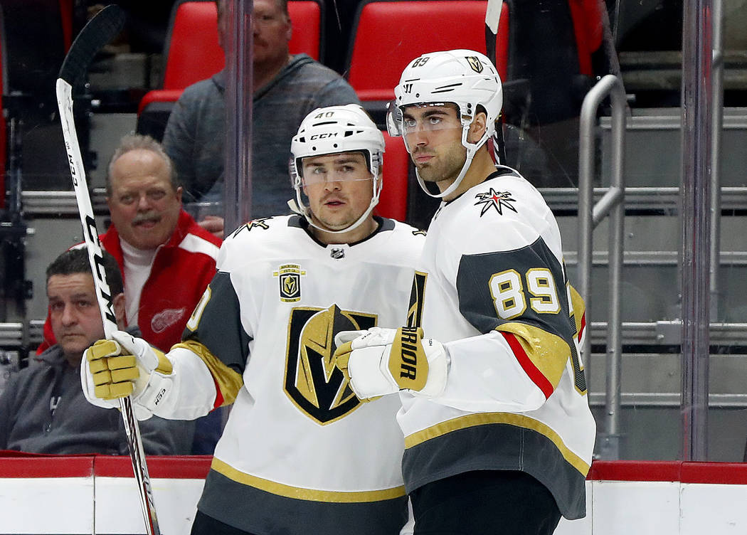 Vegas Golden Knights' Alex Tuch (89) celebrates his goal against the Detroit Red Wings with Ryan Carpenter during the first period of an NHL hockey game Thursday, March 8, 2018, in Detroit. (AP Ph ...