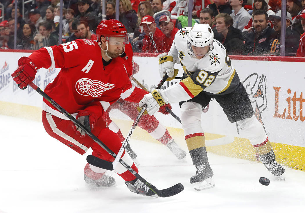 Detroit Red Wings defenseman Niklas Kronwall (55) and Vegas Golden Knights left wing Tomas Nosek (92) vie for the puck during the first period of an NHL hockey game Thursday, March 8, 2018, in Det ...