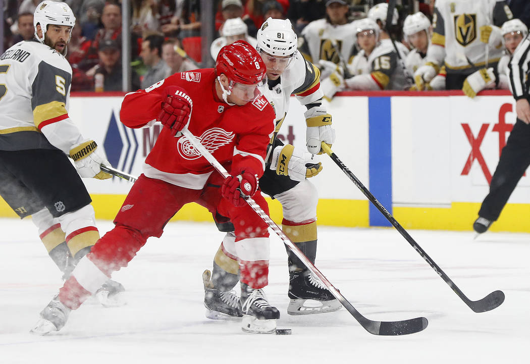 Detroit Red Wings left wing Justin Abdelkader (8) takes the puck from Vegas Golden Knights center Jonathan Marchessault (81) during the first period of an NHL hockey game Thursday, March 8, 2018,  ...