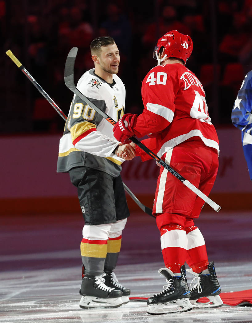 Vegas Golden Knights' Tomas Tatar (90) shakes hands with Detroit Red Wings center Henrik Zetterberg (40) before the first period of an NHL hockey game Thursday, March 8, 2018, in Detroit. (AP Phot ...