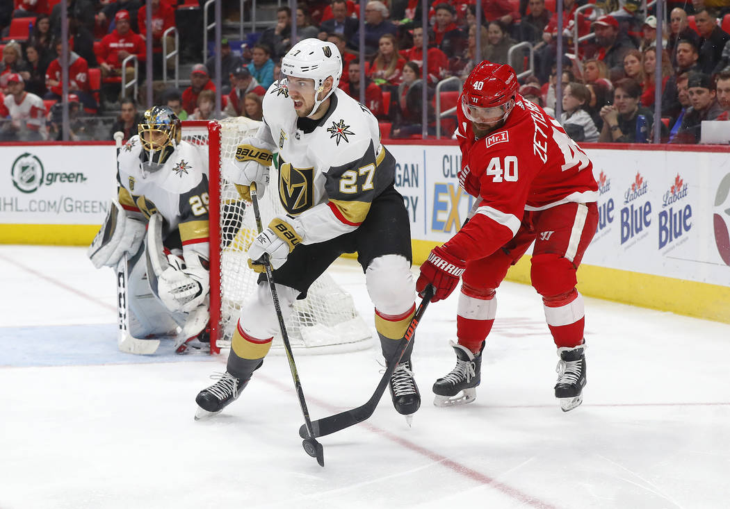 Detroit Red Wings center Henrik Zetterberg (40) lifts the puck from Vegas Golden Knights defenseman Shea Theodore (27) during the second period of an NHL hockey game Thursday, March 8, 2018, in De ...