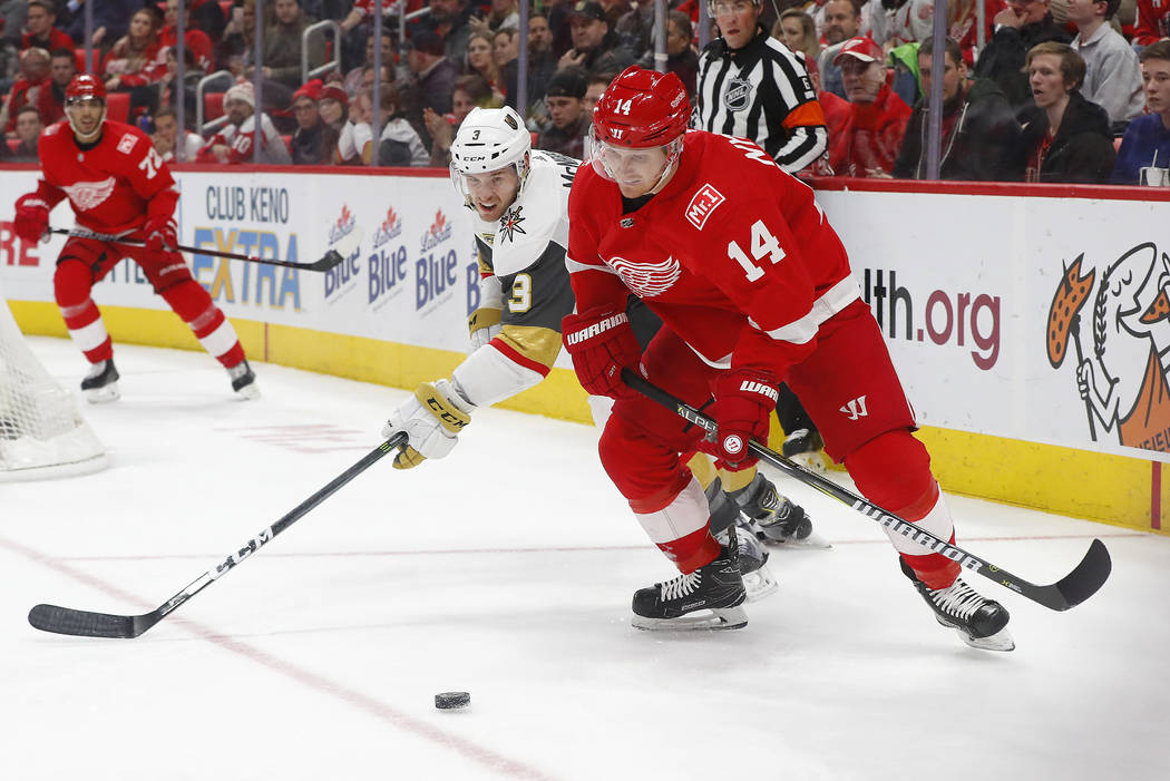 Vegas Golden Knights defenseman Brayden McNabb (3) and Detroit Red Wings right wing Gustav Nyquist (14) compete for the puck during the second period of an NHL hockey game Thursday, March 8, 2018, ...