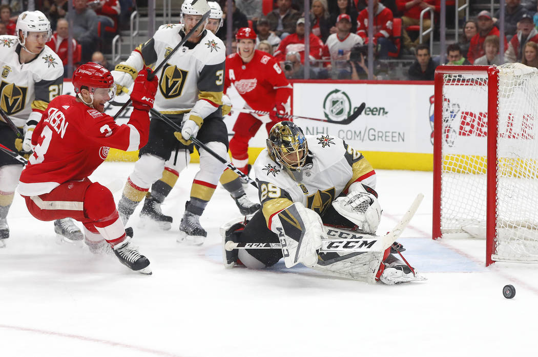 Vegas Golden Knights goaltender Marc-Andre Fleury (29) stops a shot by Detroit Red Wings defenseman Nick Jensen (3) during the second period of an NHL hockey game Thursday, March 8, 2018, in Detro ...