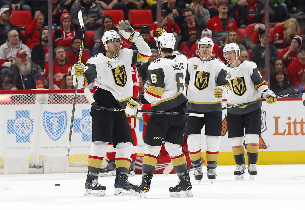 Vegas Golden Knights right wing Alex Tuch, left, celebrates his goal against the Detroit Red Wings with Colin Miller (6) during the second period of an NHL hockey game Thursday, March 8, 2018, in  ...