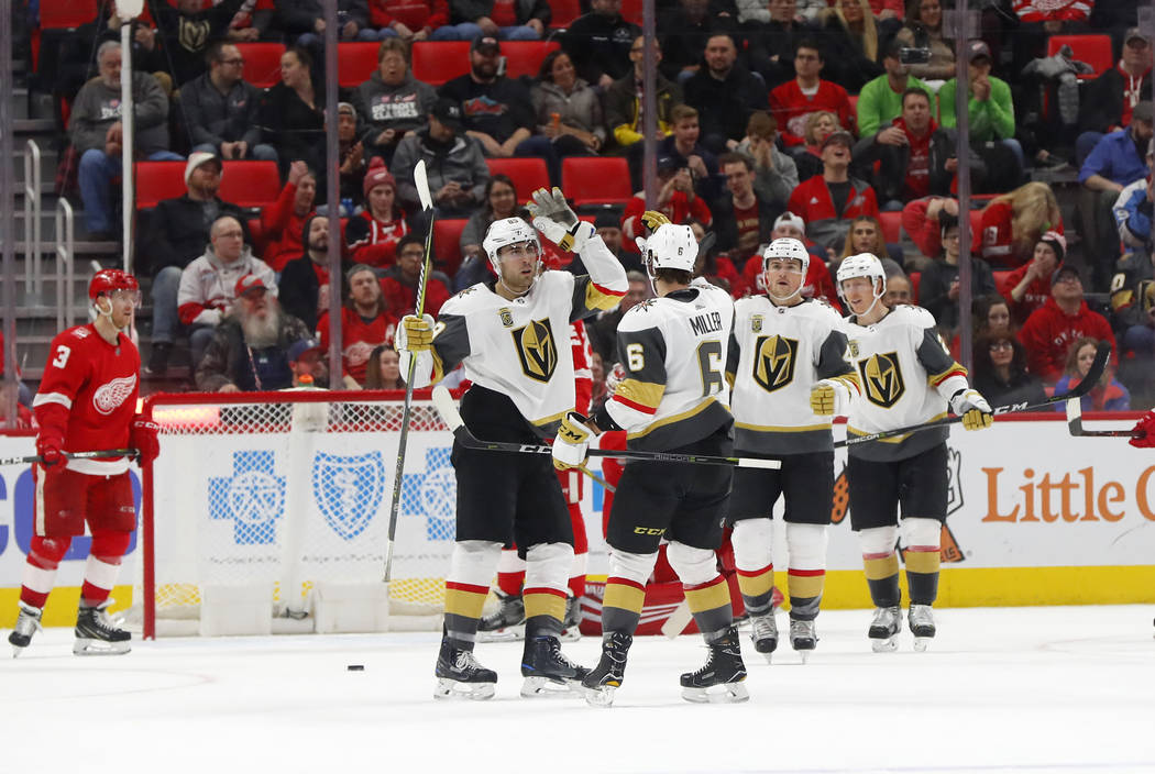 Vegas Golden Knights right wing Alex Tuch, left, celebrates his goal against the Detroit Red Wings with Colin Miller (6) in the second period of an NHL hockey game Thursday, March 8, 2018, in Detr ...