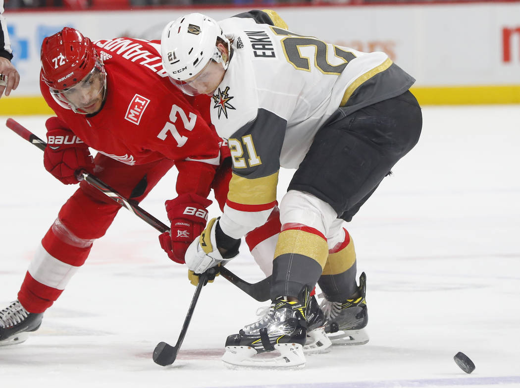 Detroit Red Wings left wing Andreas Athanasiou (72) and Vegas Golden Knights center Cody Eakin (21) battle during a face-off in the second period of an NHL hockey game Thursday, March 8, 2018, in  ...
