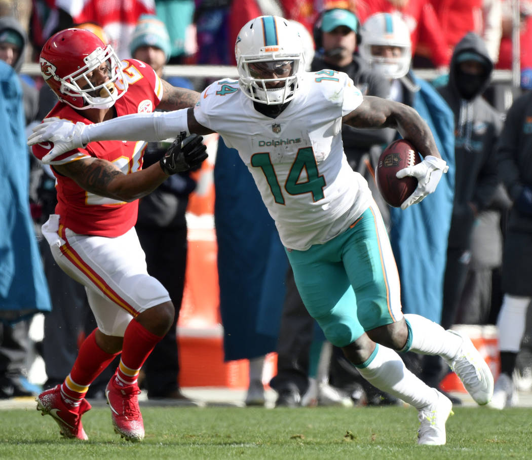 In this Dec. 24, 2017, file photo, Miami Dolphins wide receiver Jarvis Landry (14) runs away from Kansas City Chiefs defensive back Steven Nelson (20) during the first half of an NFL football game ...