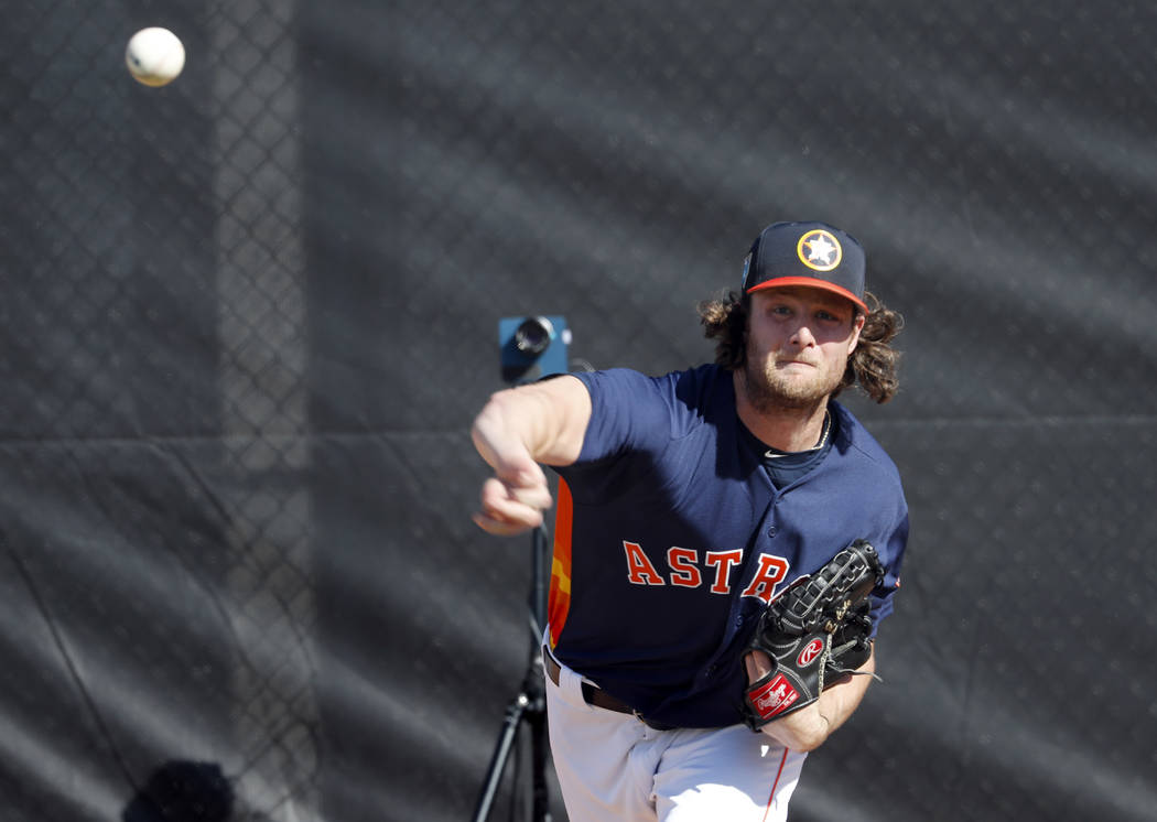 Houston Astros pitcher Gerrit Cole throws a bullpen session during spring training baseball practice Thursday, Feb. 15, 2018, in West Palm Beach, Fla. (AP Photo/Jeff Roberson)