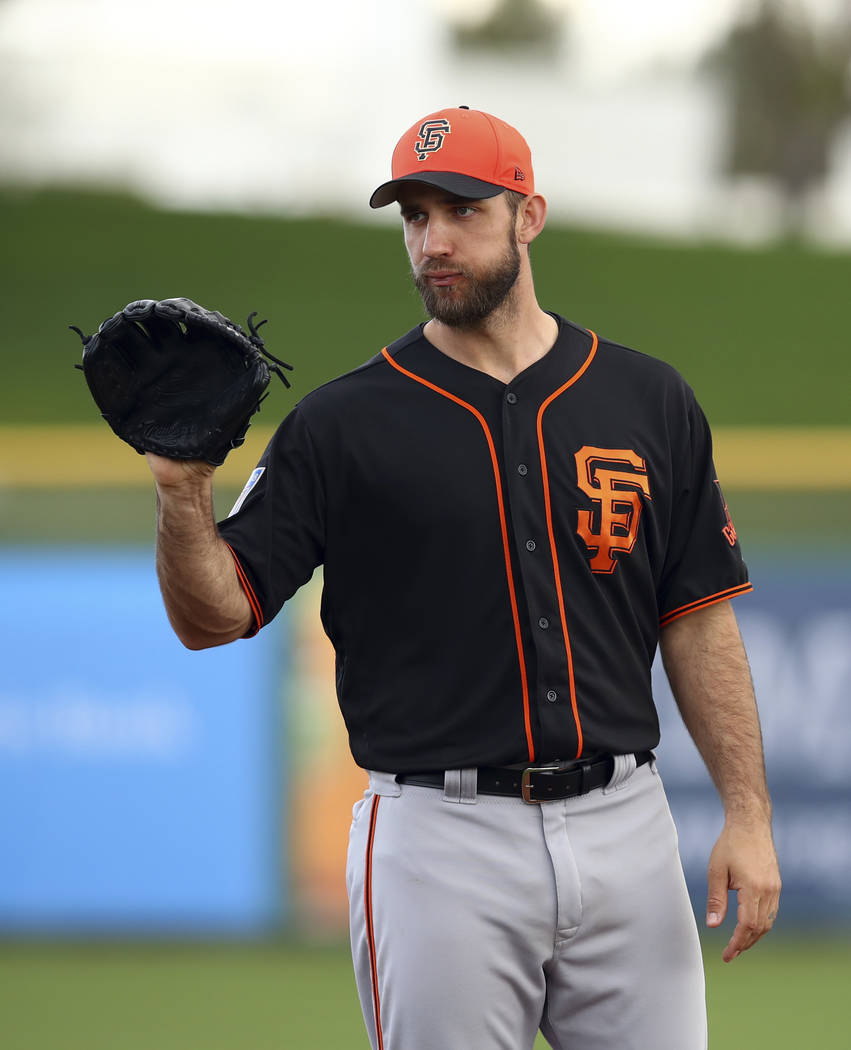 San Francisco Giants' Madison Bumgarner during a spring training baseball practice on Monday, Feb. 19, 2018 in Scottsdale, Ariz. (AP Photo/Ben Margot)