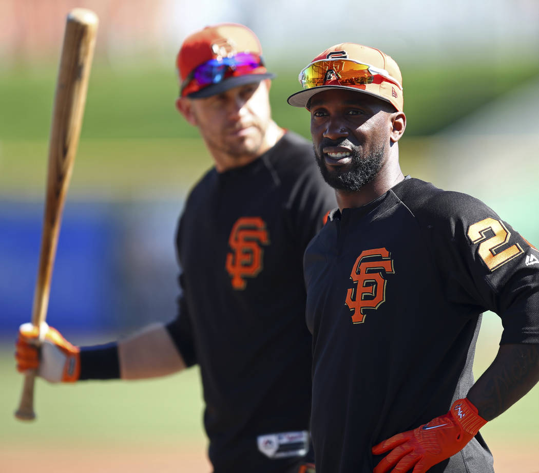 San Francisco Giants' Evan Longoria, left, and Andrew McCutchen wait to bat during practice prior to a spring training baseball game against the Arizona Diamondbacks on Tuesday, Feb. 27, 2018, in  ...