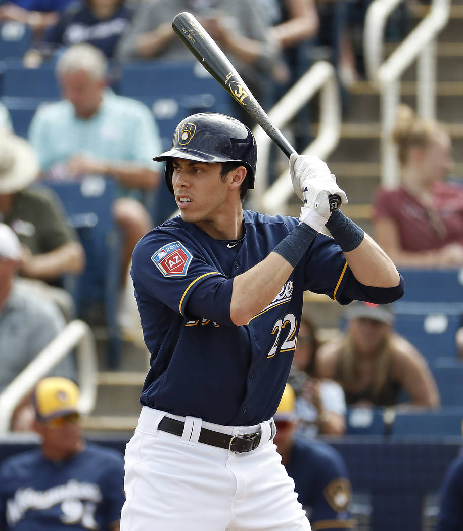 Milwaukee Brewers' Christian Yelich hits against the Arizona Diamondbacks during the first inning of a spring training baseball game Thursday, March 8, 2018, in Phoenix. (AP Photo/Matt York)
