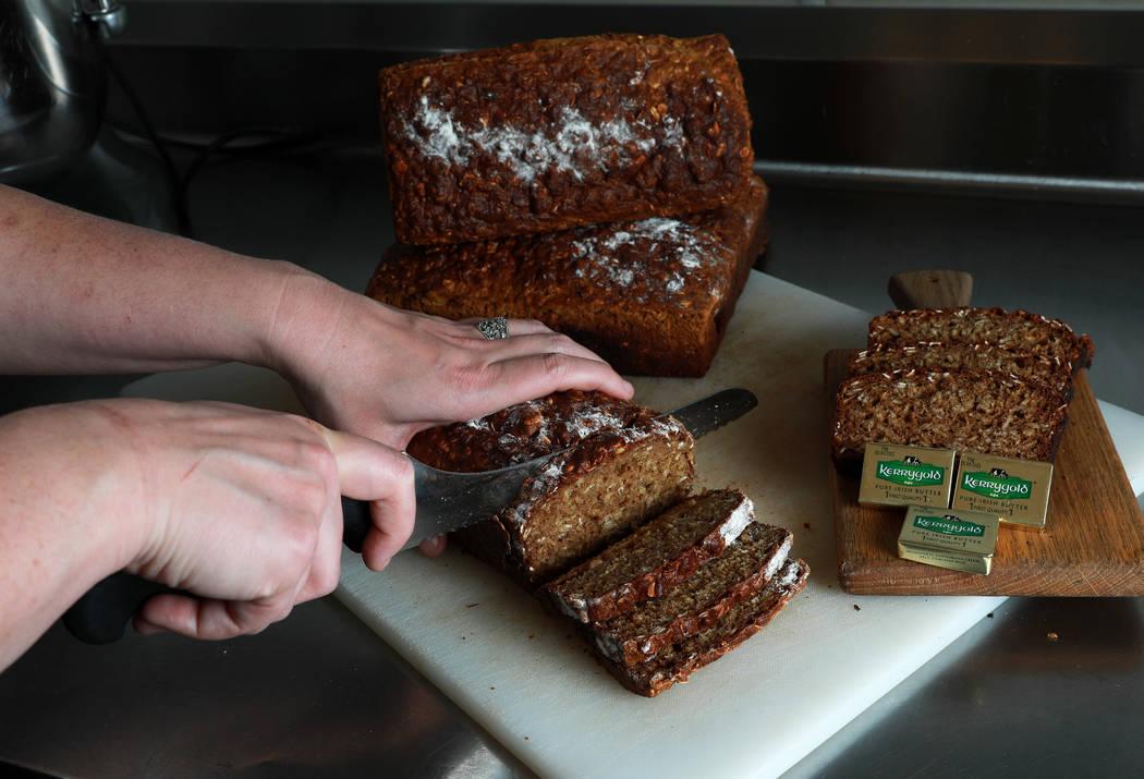 Shae Wafford, 28, sous chef, cuts up slices of Irish soda bread at Ri Ra Irish Pub in Las Vegas on Friday, March 9, 2018. Andrea Cornejo Las Vegas Review-Journal @DreaCornejo