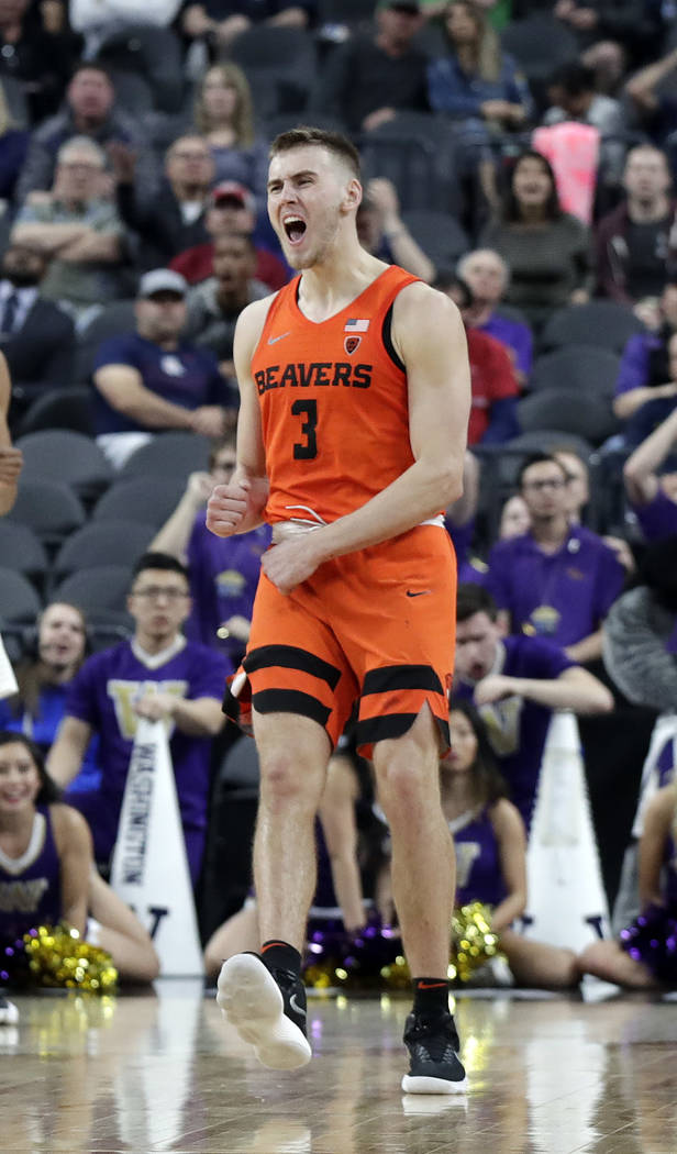 Oregon State's Tres Tinkle reacts during overtime of the team's NCAA college basketball game against Washington in the first round of the Pac-12 men's tournament Wednesday, March 7, 2018, in Las V ...
