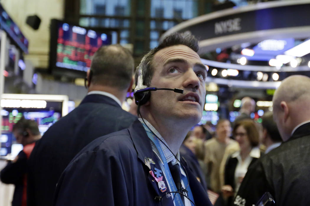 Trader Gregory Rowe works on the floor of the New York Stock Exchange, Friday, March 2, 2018. Stocks are opening lower Friday as investors remain concerned that President Donald Trump's plan to im ...