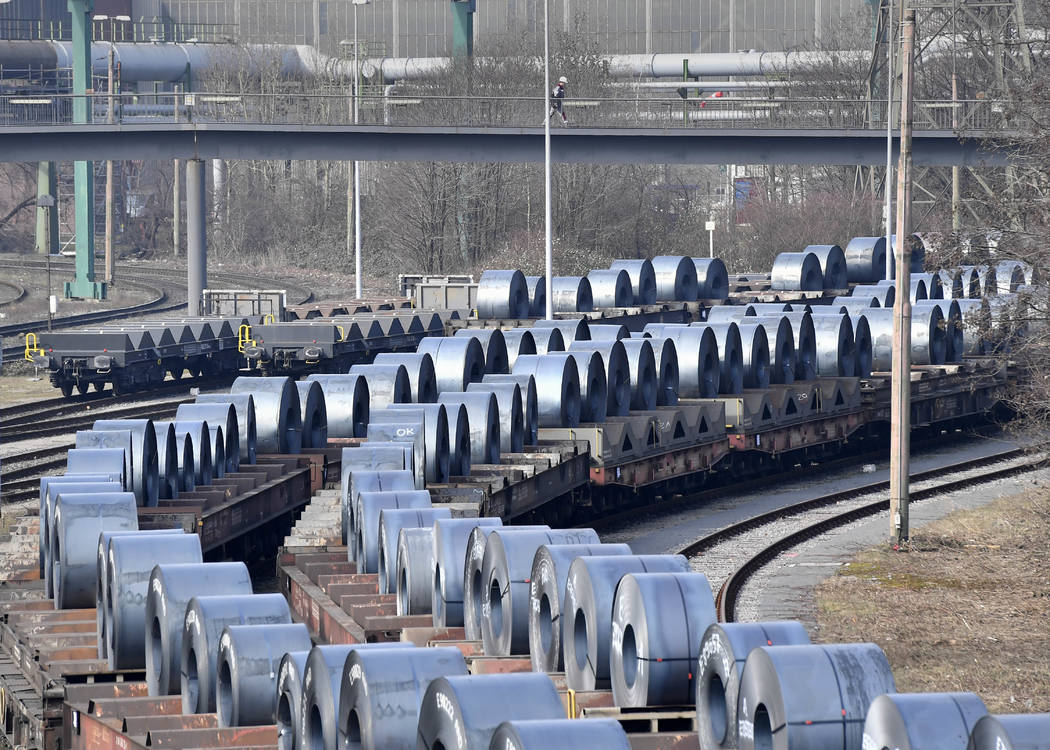 Steel coils sit on wagons when leaving the thyssenkrupp steel factory in Duisburg, Germany, Friday, March 2, 2018. U.S. President Donald Trump risks sparking a trade war with his closest allies if ...