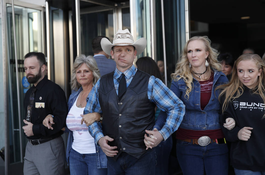 "Ryan Payne, left, Jeanette Finicum, widow of Robert ""LaVoy"" Finicum, Ryan Bundy, Angela Bundy, wife of Ryan Bundy, and Jamie Bundy, daughter of Ryan Bundy, walk out of a federal courthouse in Las  ..."
