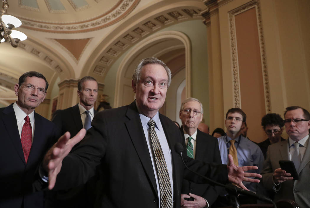 Sen. Mike Crapo, R-Idaho, chairman of the Senate Banking Committee, joined by, from left, Sen. John Barrasso, R-Wyo., Sen. John Thune, R-S.D., and Senate Majority Leader Mitch McConnell, R-Ky., ri ...
