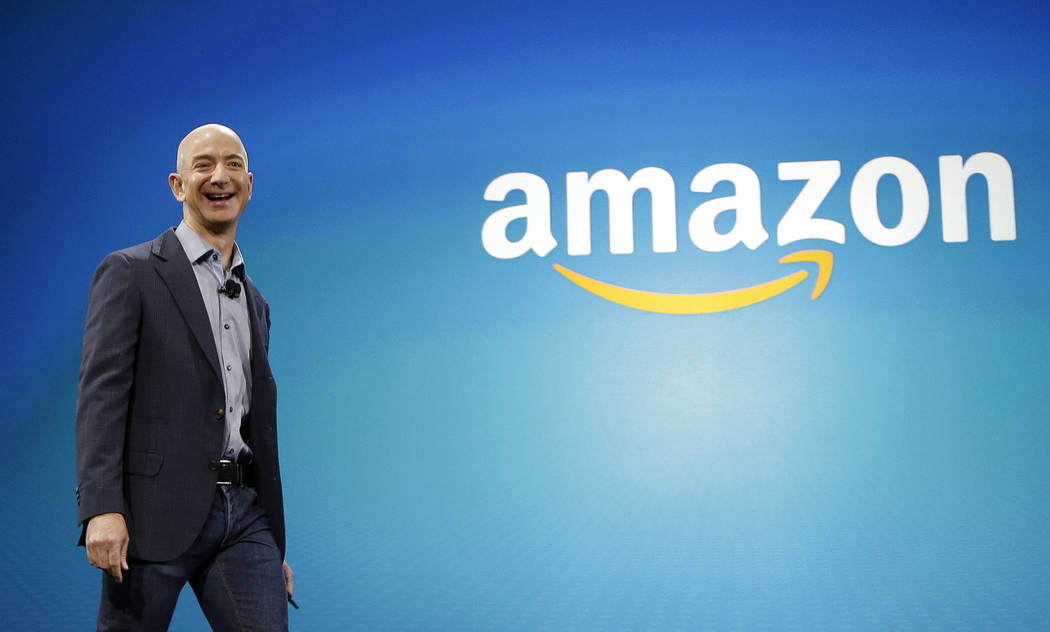 FILE - In this June 16, 2014, file photo, Amazon CEO Jeff Bezos in Seattle. (AP Photo/Ted S. Warren, File)