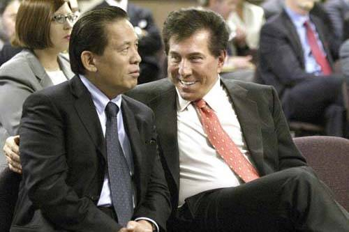 Las Vegas casino mogul Steve Winn, right, talking with his business partner Kazuo Okada during a Gaming Commission hearing in Carson City, Nev., June 17, 2004.  (Las Vegas Review-Journal, File)