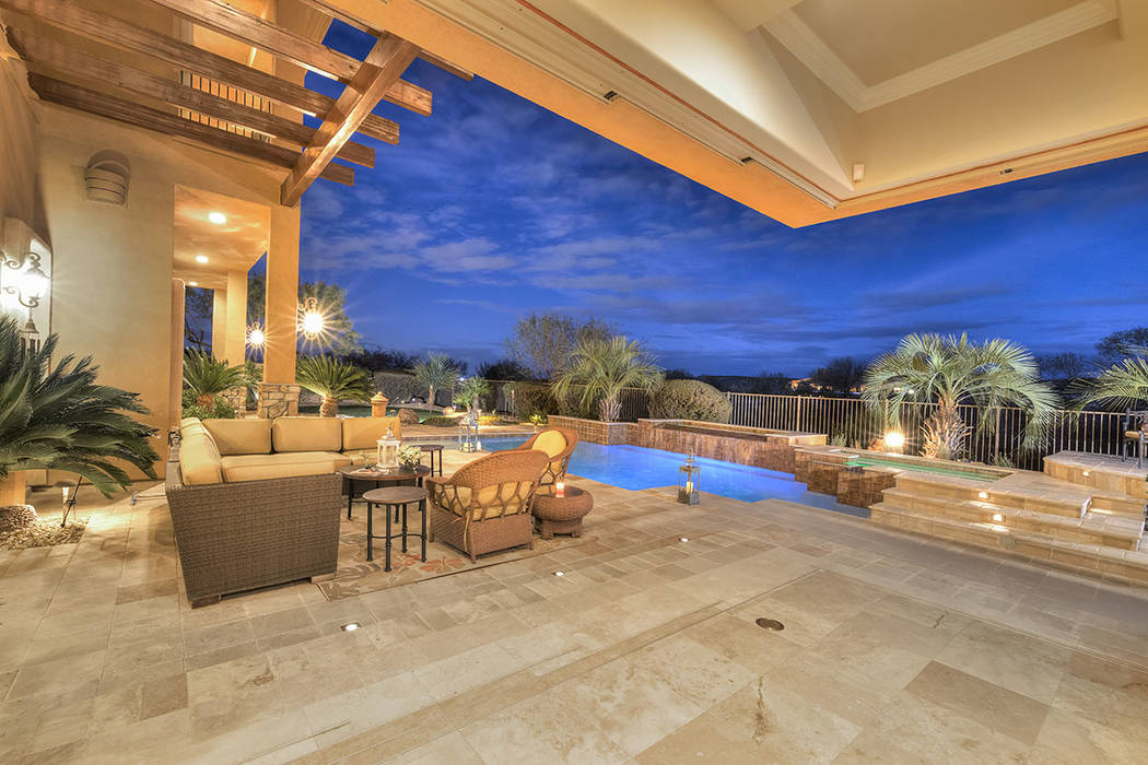 The pool and spa area provides space for entertaining. (Synergy/Sotheby's International Realty)