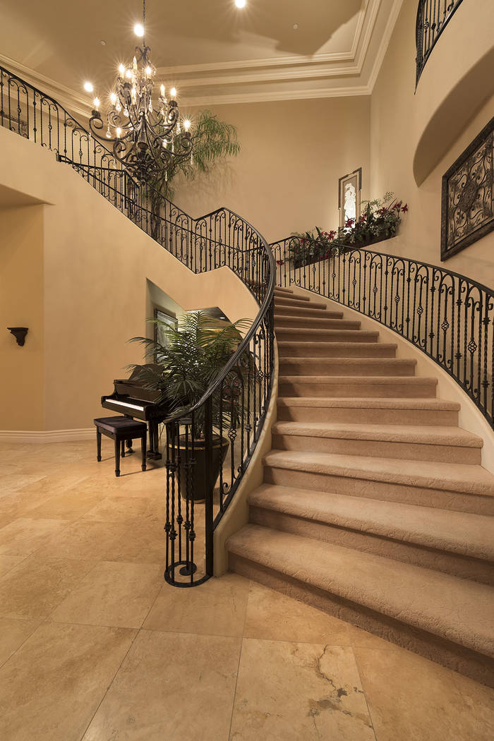 The grand staircase connects the two stories. (Synergy/Sotheby's International Realty)