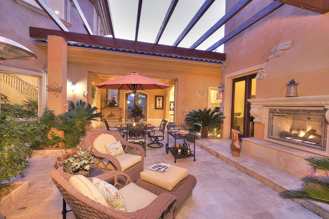 The home features an outdoor fireplace. (Synergy/Sotheby's International Realty)