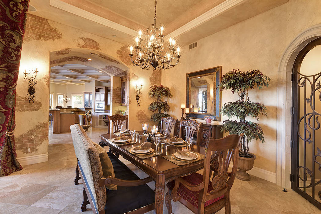 The formal dining room has a Tuscan touch. (Synergy/Sotheby's International Realty)