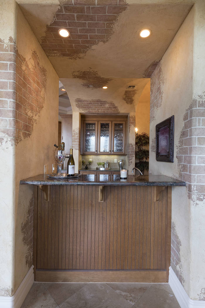 The home was built for entertaining and has several bars. (Synergy/Sotheby's International Realty)