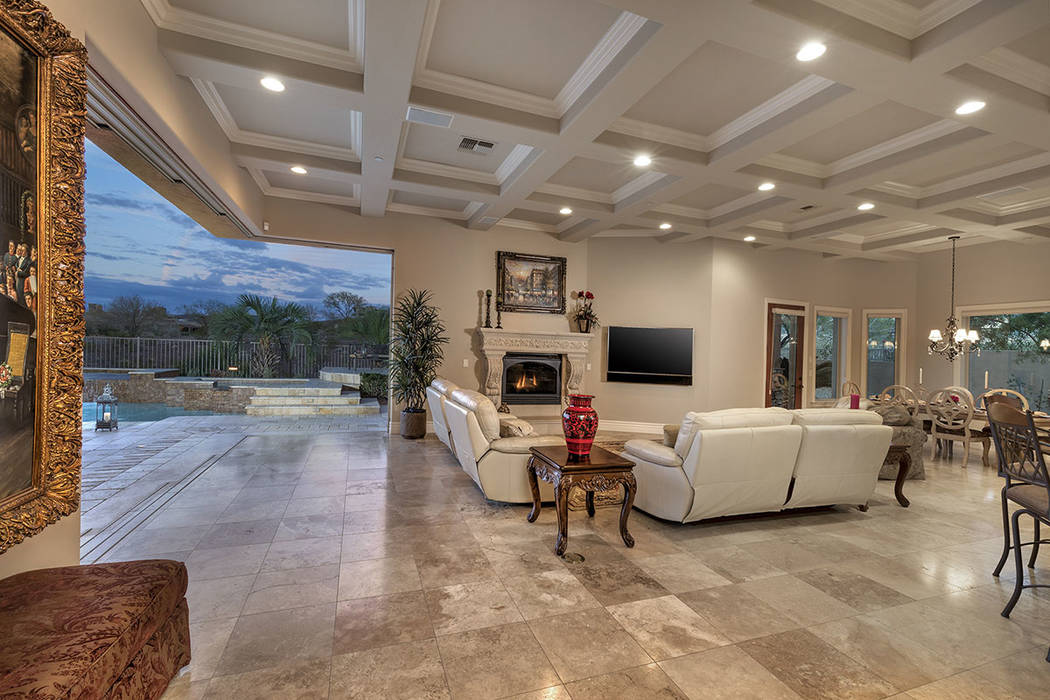 The living room opens to the spa and pool. (Synergy/Sotheby's International Realty)