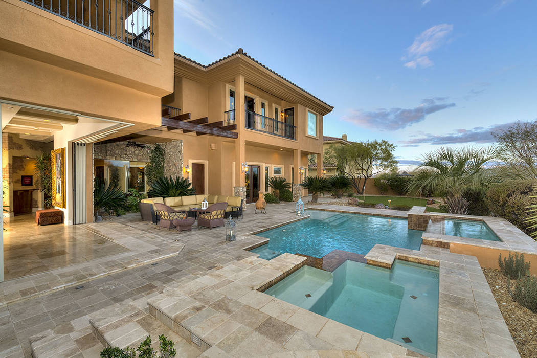 The home has a pool, spa and outdoor kitchen.  (Synergy/Sotheby's International Realty)