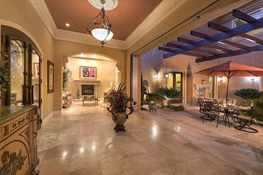 The home features outdoor-indoor living. (Synergy/Sotheby's International Realty)
