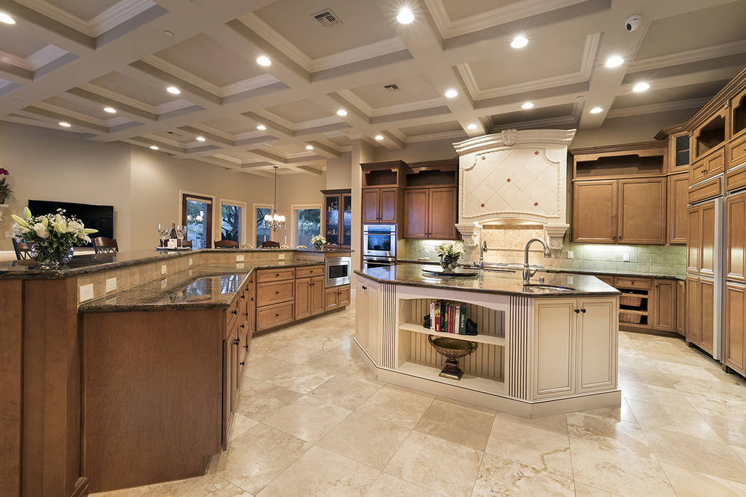 The kitchen is equipped with custom maple cabinets and professional grade General Electric Monogram appliances, including double dishwashers, cooktop and double ovens. (Synergy/Sotheby's Interna ...