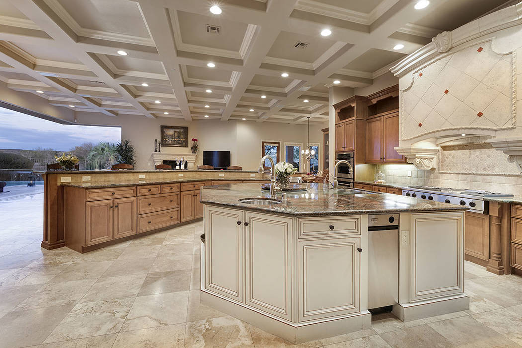 The kitchen opens  to the patio. (Synergy/Sotheby's International Realty)