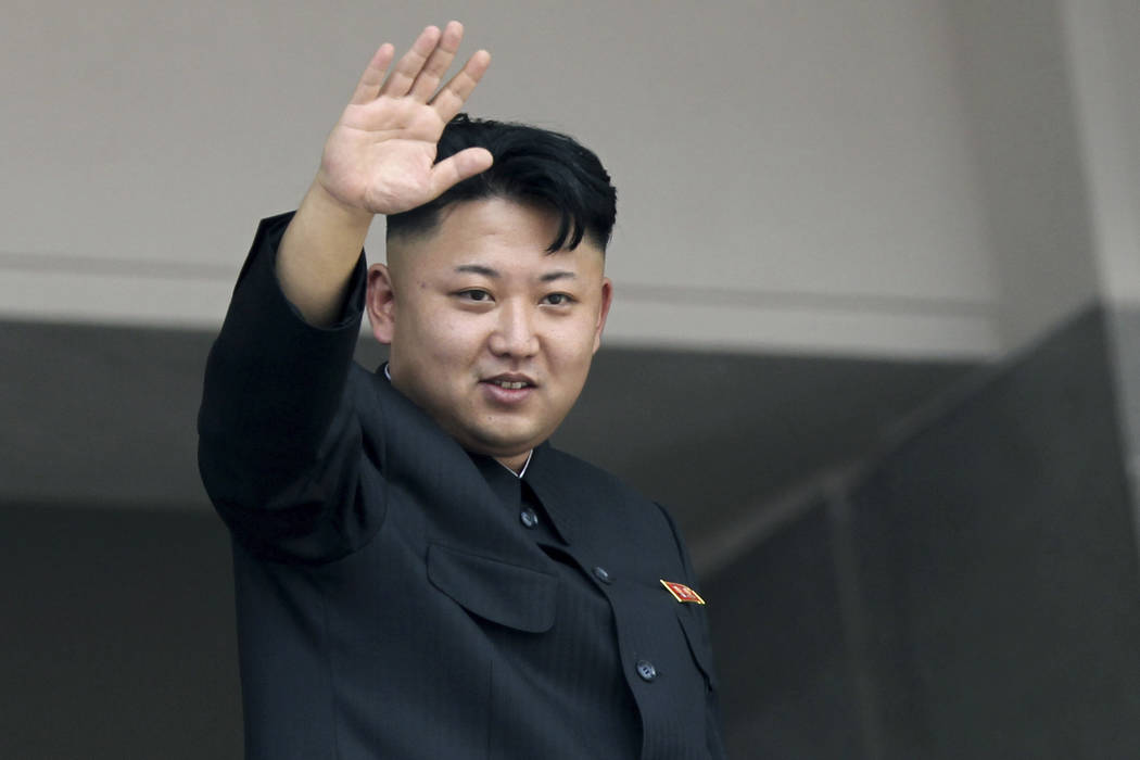North Korea's leader Kim Jong Un waves to spectators and participants of a mass military parade celebrating the 60th anniversary of the Korean War armistice in Pyongyang, North Korea, in 2013.  (A ...