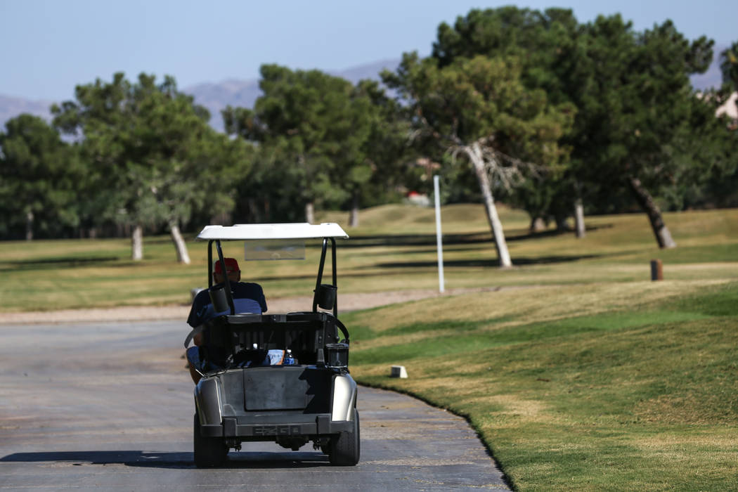 A worker drives at Legacy Golf Club in Henderson, Thursday, Oct. 12, 2017. (Joel Angel Juarez/Las Vegas Review-Journal) @jajuarezphoto