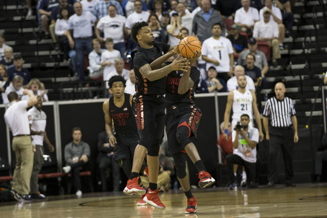 UNLV Rebels guard Kris Clyburn (1) and forward Tervell Beck (14) collide going for a loose ball in the second half of the Mountain West Conference men's basketball tournament game at the Thomas &a ...