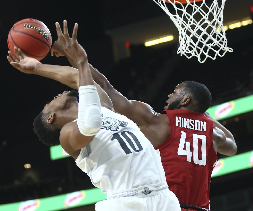 Washington State Cougars guard Kwinton Hinson (40) blocks a shot from Oregon Ducks guard Victor Bailey Jr. (10) during the Pac-12 basketball tournament at T-Mobile Arena in Las Vegas on Wednesday, ...