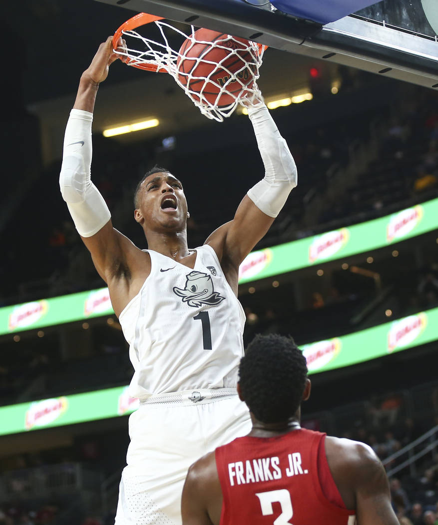 Oregon Ducks forward Kenny Wooten (1) dunks against the Washington State Cougars during the Pac-12 basketball tournament at T-Mobile Arena in Las Vegas on Wednesday, March 7, 2018. Chase Stevens L ...