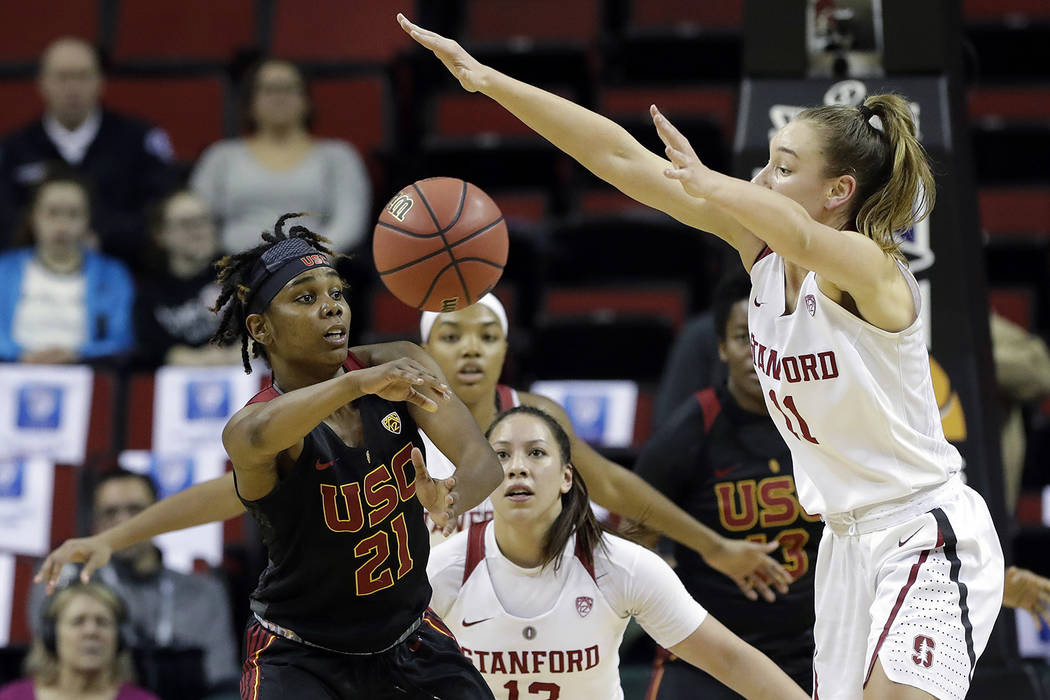 Southern California's Aliyah Mazyck (21) passes the ball as Stanford's Alanna Smith (11) and Marta Sniezek defend during the first half of an NCAA college basketball game in the quarterfinals of t ...