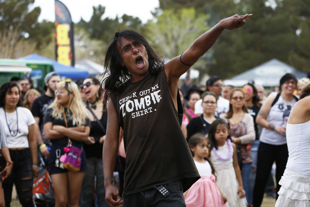 A man who wished to be identified as Crow, 23, dances to Los Ataskados during the first Tacos and Tamales Festival, organized by the Clark County Parks and Recreation, at Sunset Park in Las Vegas  ...