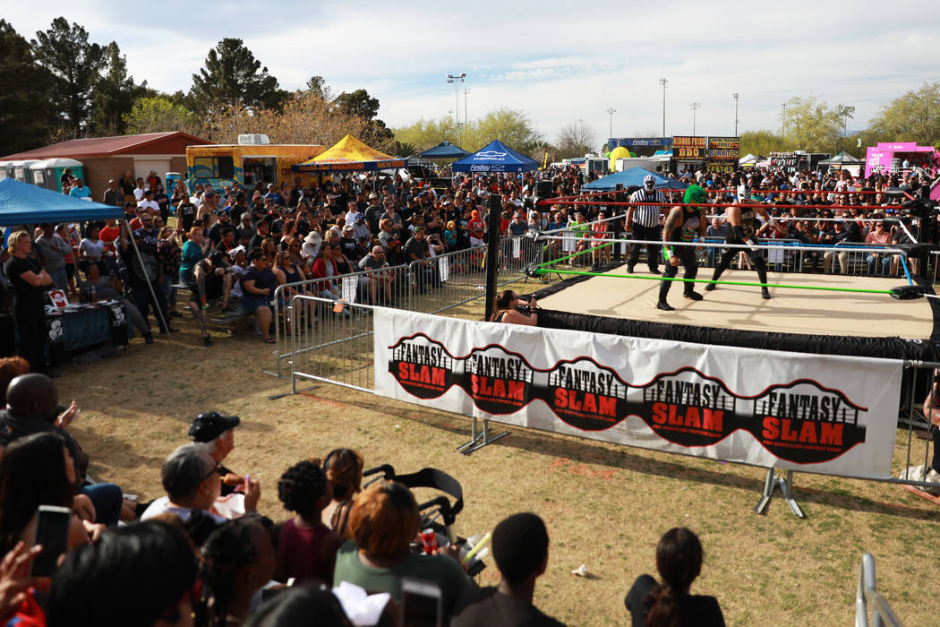 Attendees watch a Lucha Libre match during the first Tacos and Tamales Festival, organized by the Clark County Parks and Recreation, at Sunset Park in Las Vegas on Saturday, March 31, 2018. The ev ...