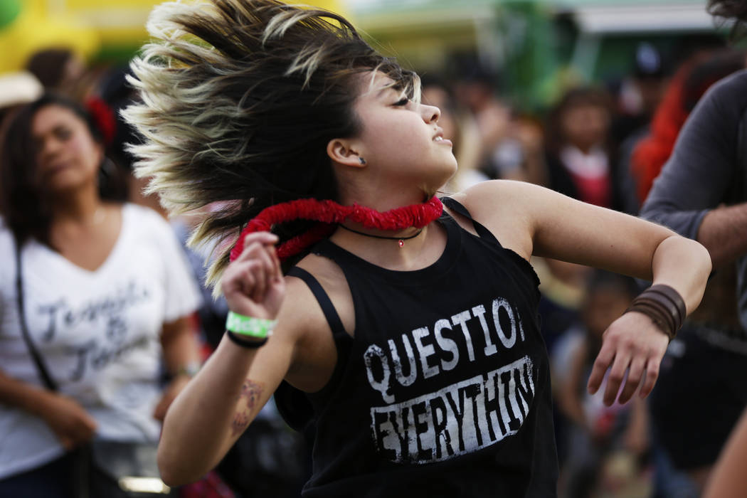 Marlyn Navarro, 25, dances to Los Ataskados during the first Tacos and Tamales Festival, organized by the Clark County Parks and Recreation, at Sunset Park in Las Vegas on Saturday, March 31, 2018 ...