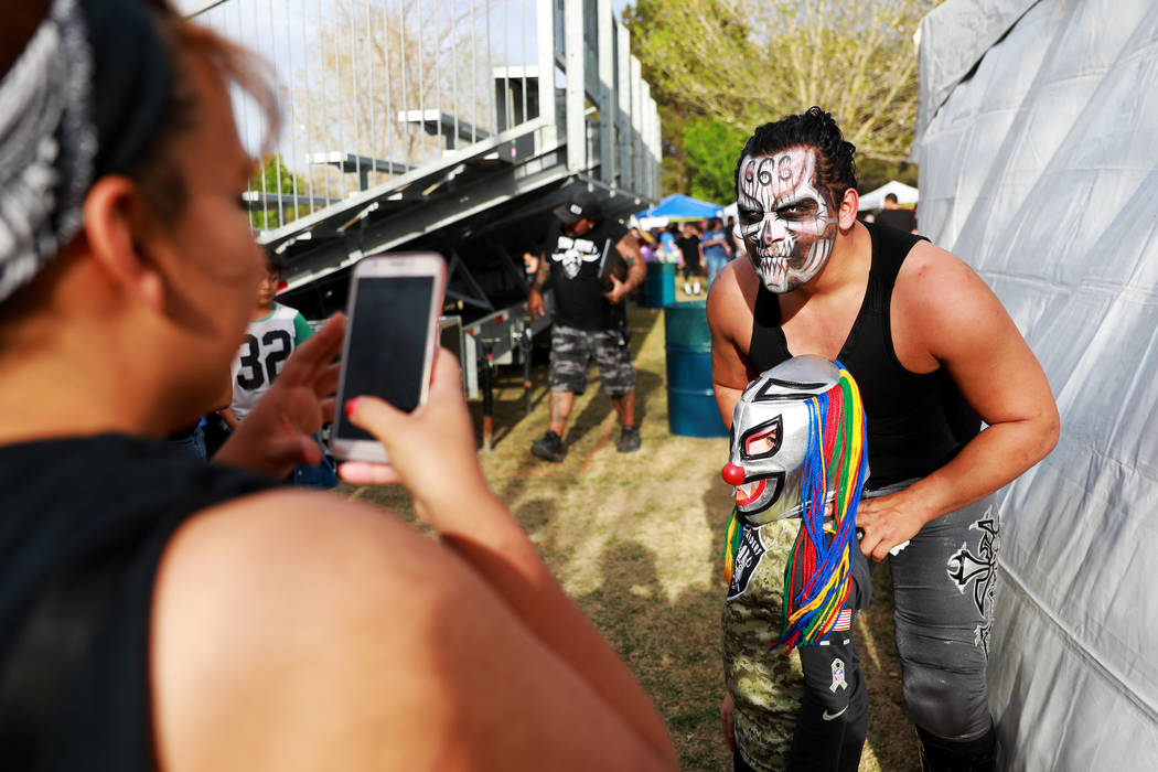 Bestia 666 poses for a photo with Cash Castro during the first Tacos and Tamales Festival, organized by the Clark County Parks and Recreation, at Sunset Park in Las Vegas on Saturday, March 31, 20 ...