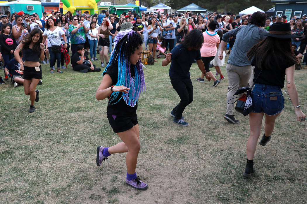 Cindy Espinosa, 28, dances to Los Ataskados during the first Tacos and Tamales Festival, organized by the Clark County Parks and Recreation, at Sunset Park in Las Vegas on Saturday, March 31, 2018 ...