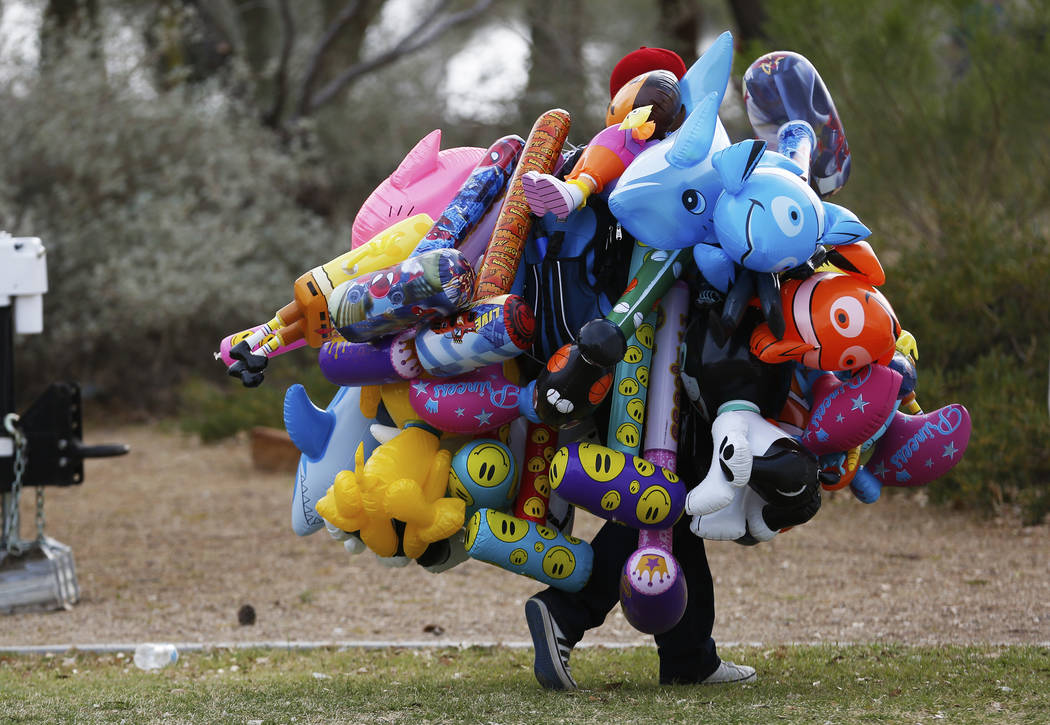 A man sells inflatable toys during the first Tacos and Tamales Festival, organized by the Clark County Parks and Recreation, at Sunset Park in Las Vegas on Saturday, March 31, 2018. The event feat ...