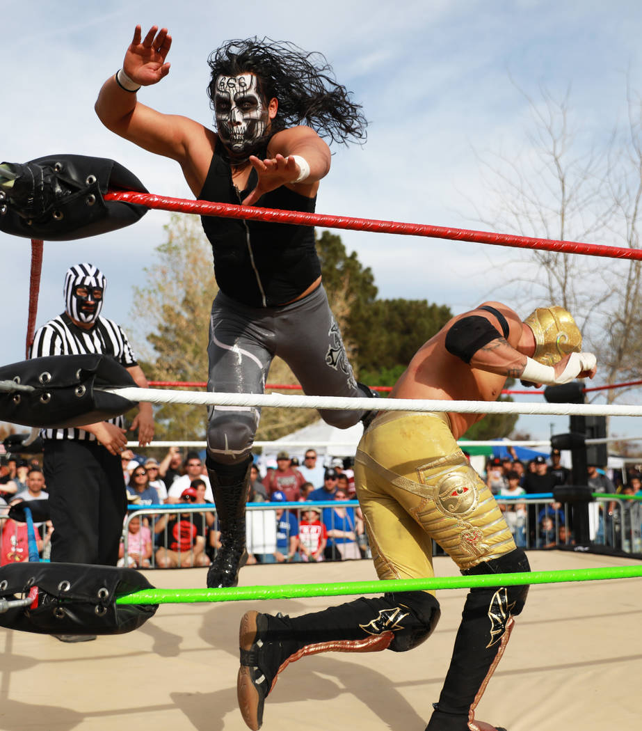 Bestia 666 wrestles Rey Horus during the first Tacos and Tamales Festival, organized by the Clark County Parks and Recreation, at Sunset Park in Las Vegas on Saturday, March 31, 2018. The event fe ...
