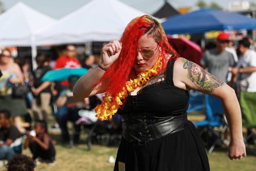 Aimi Skillingstad dances to The Tiki Bandits during the first Tacos and Tamales Festival, organized by the Clark County Parks and Recreation, at Sunset Park in Las Vegas on Saturday, March 31, 201 ...