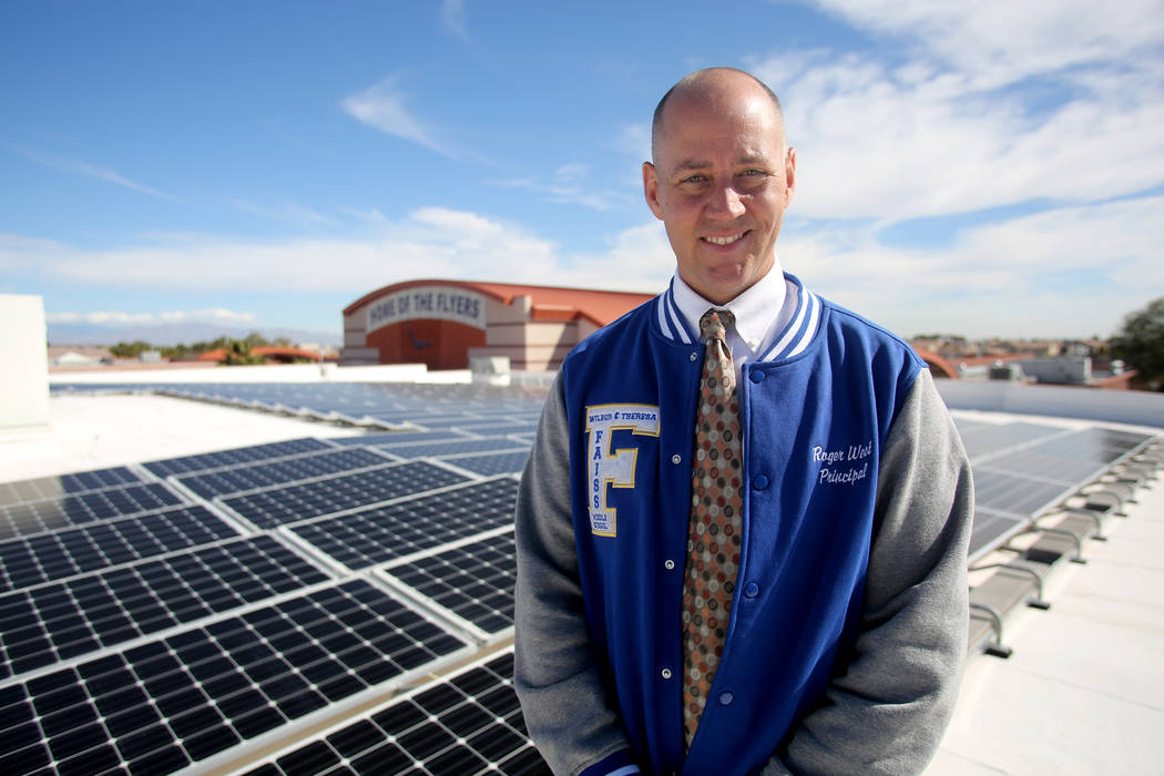 Roger West, principal of Wilbur and Theresa Faiss Middle School, stands in front of the school's rooftop solar panels on Monday, March 12, 2018. Michael Quine Las Vegas Review-Journal @Vegas88s