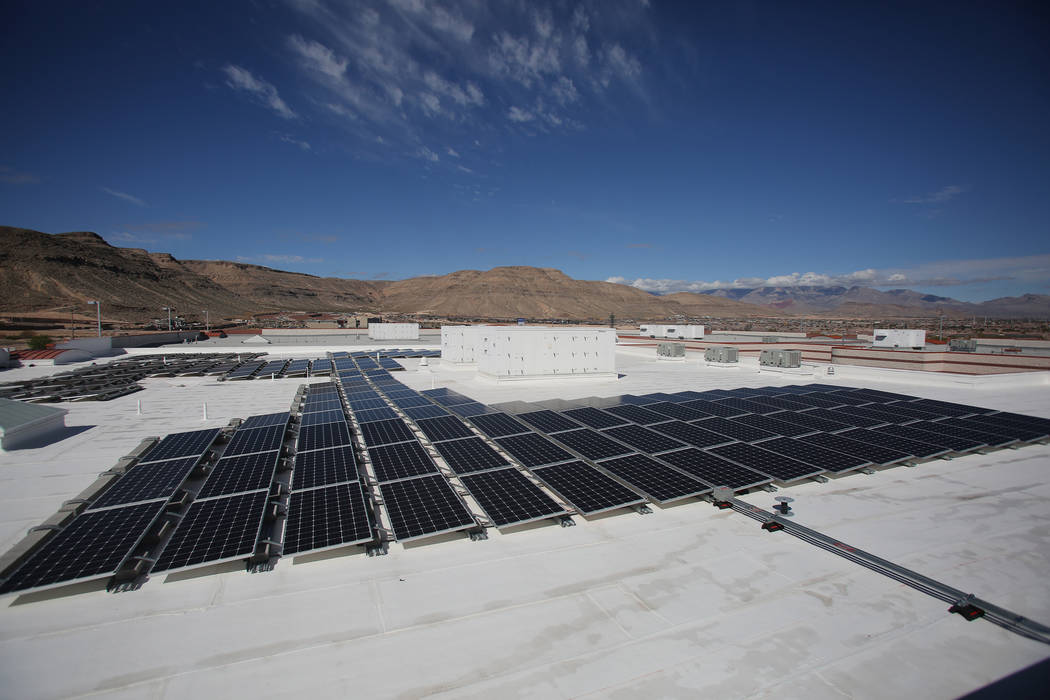 Solar panels line the roof of Wilbur and Theresa Faiss Middle School on Monday, March 12, 2018, one of 42 CCSD schools with solar panel installations, saving approximately $514,000 per year in ene ...