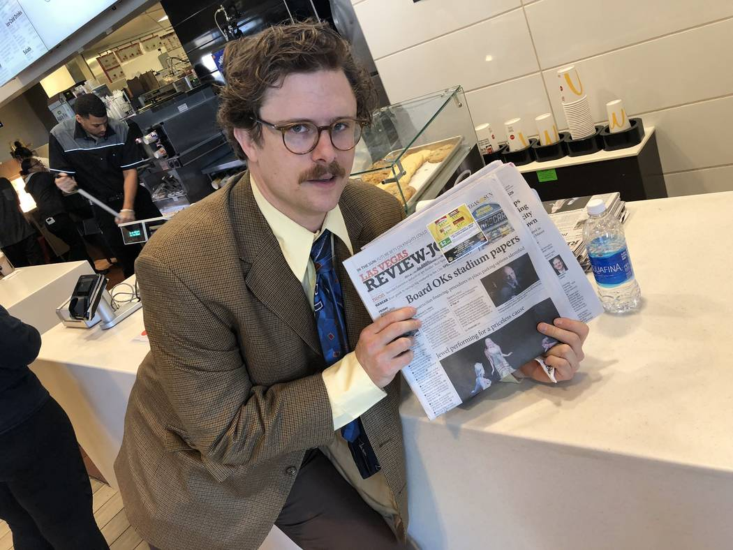 """""""Opium"""" character/producer Harry M. Howie is shown with a copy of the Review-Journal at McDonald's on West Tropicana Avenue on Friday, March 2, 2018.  (John Katsilometes/Las Vegas Review-Journal)  ..."""